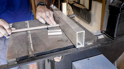 Cutting the dowels into short lengths on the band saw