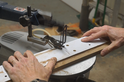 Cutting the dust port opening with the scroll saw