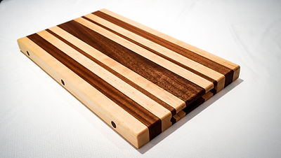 Sipo and maple edge grain cutting board