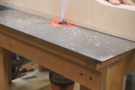 Cutting a 45 degree chamfer along the inside bottom edge of the fence