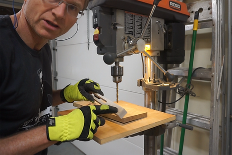 Preparing the side arms at the drill press