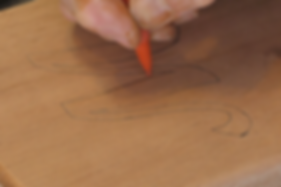 Photo of pattern being traced with pencil