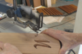 """Photo of using scroll saw to cut out the """"M"""""""