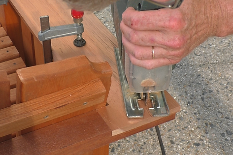 Photo of using jig saw to round corners of arm rest