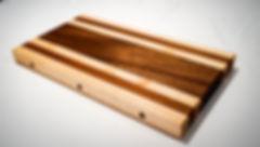 Maple, walnut and sipo cutting board