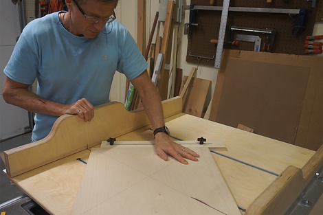 Using the first jig to cut the MDF into two triangles