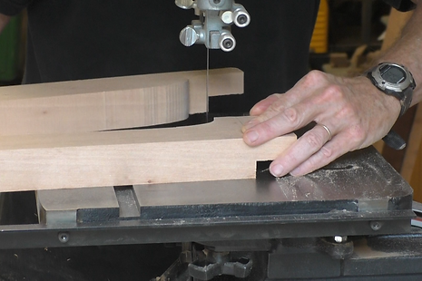 Photo of band saw cutting the profile of the front edge of the seat support