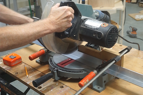 Cutting the L bracket on the miter saw