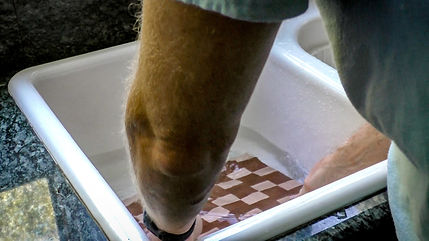Soaking the cutting board in water