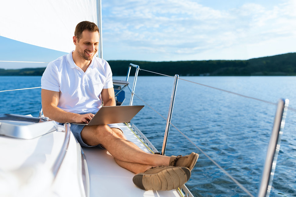 Happy Man On Yacht Sitting With Laptop W