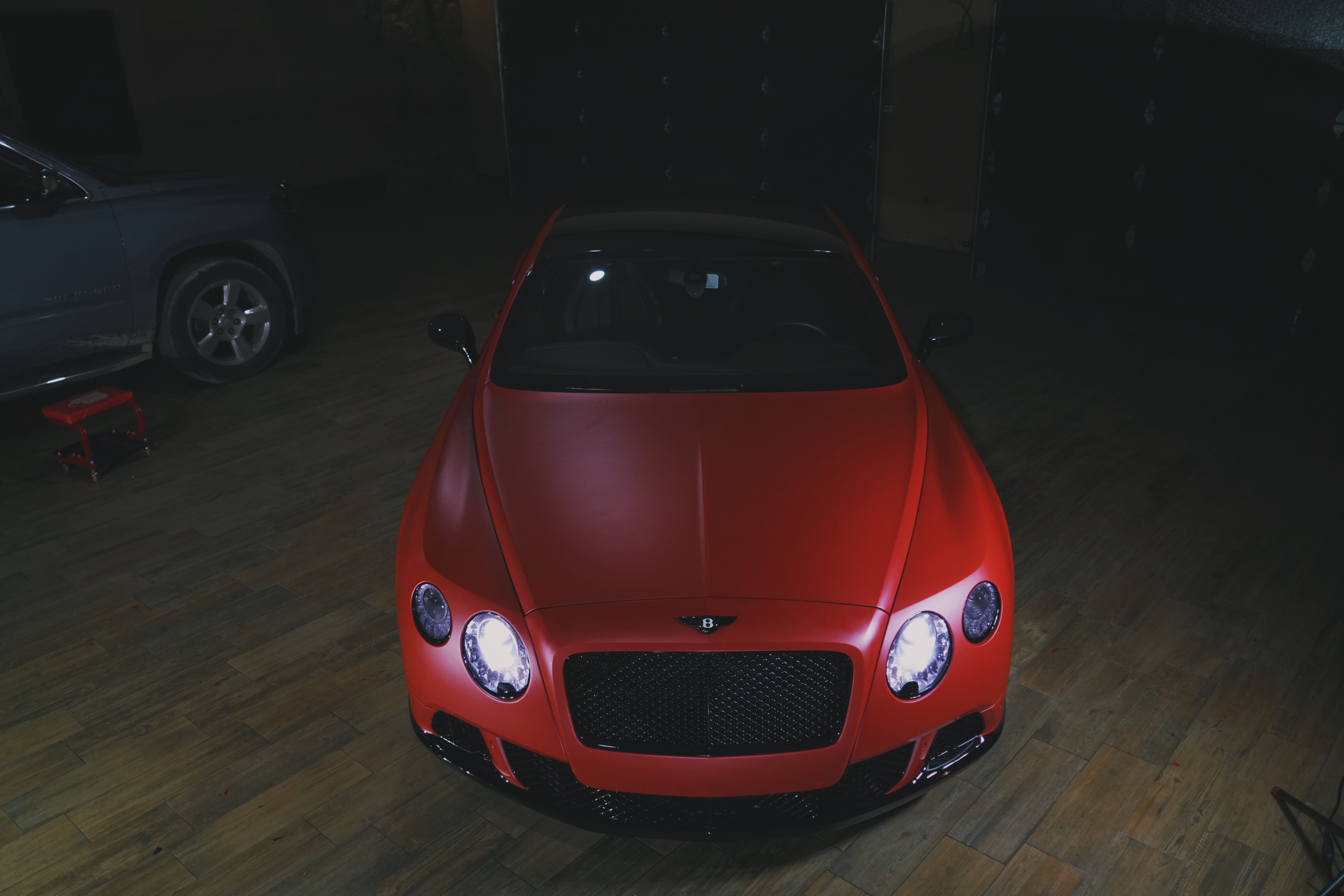 matte metallic lava red Bentley