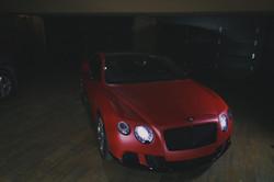 matte metallic lava red Bentley