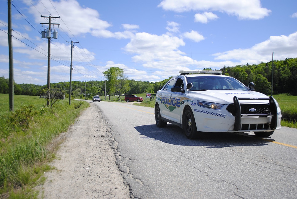 MRC des Collines Police conducted spike strip training on Chemin Maclaren in Wakefield on May 28. A recent report on police across Quebec recommended reducing the number of police departments like the MRC des Collines Police. Hunter Cresswell photo