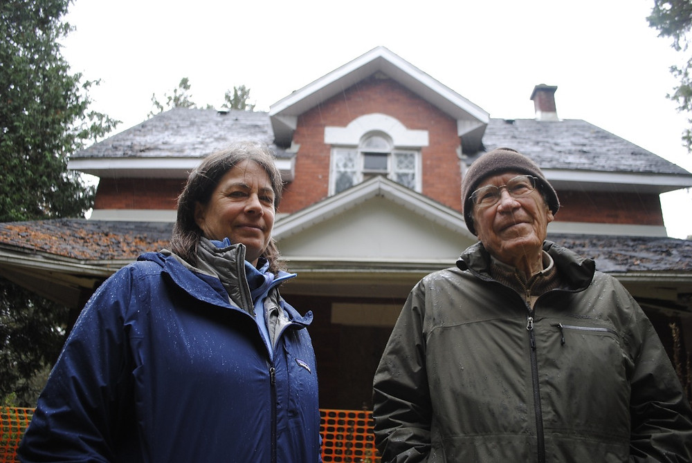 Claire Miquet and her father, Jean Miquet, look at the state of their old Meech Creek Valley home that they left in 1981 and has since fallen into disrepair. Hunter Cresswell photo