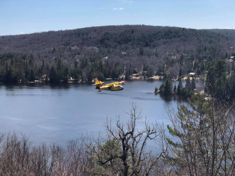One of two bombers that scooped water from the Gatineau River to fight a fire near Mont Cascades on the afternoon of April 28. Photo courtesy David Erickson