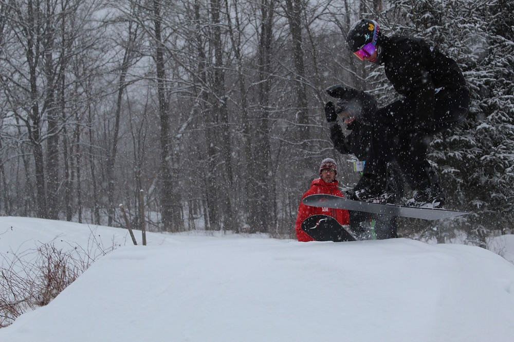 Griffin Mason gets some early morning air with his brother on the custom snowboard cross run his dad and coach, Tom, built for him in their front yard, where Mason can practice as long as he wants without worrying about crowds or a curfew. Stuart Benson photo