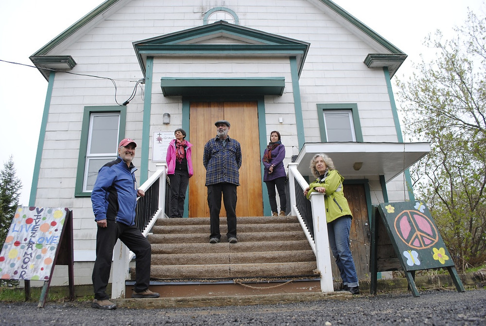 (From left) Purchase financier Sandy Foote, La Fab treasurer Danielle Pronovost, La Fab board president Glen Foster, La Fab board member Danielle Gingras, and Mill Road Community Space performance arts director and purchase financier Roberta Walker on the steps of Grace United Church in Chelsea, which La Fab will take possession of this summer. Hunter Cresswell photo