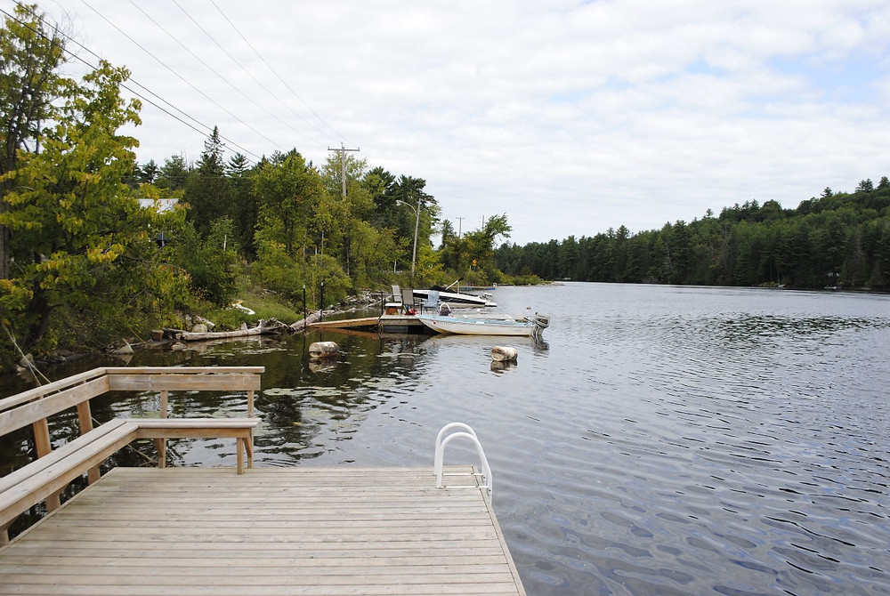 Docks like these have long dotted the banks of the Gatineau River in Chelsea, and the municipality is still working on the draft bylaw that would regulate them. Low Down file photo