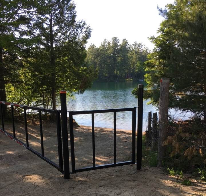Non-Danford Lake Kazabazua residents have expressed frustration that this metal gate now blocks access to a Danford Lake swim spot and boat ramp, near the intersection of Chemin du Lac Danford Ouest and Rue Davies, which has always been private property, but public use was formerly tolerated by the previous owner. Photo courtesy Shelley Merrifield