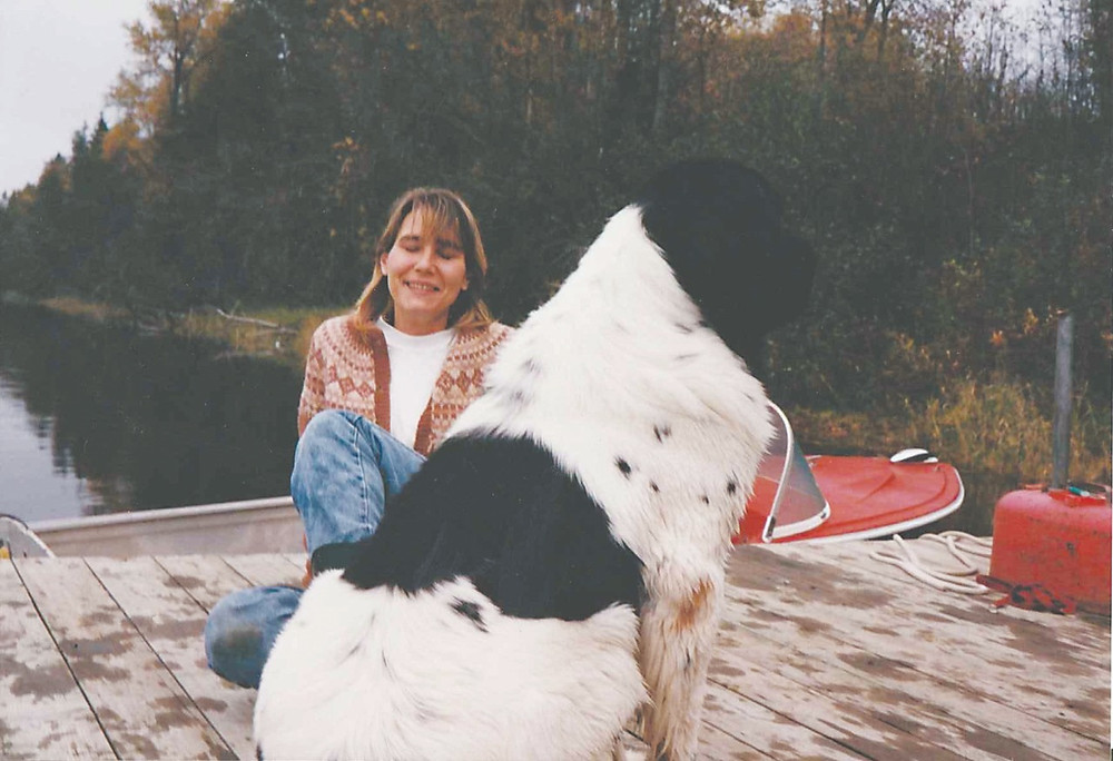 Ellen Drblik seen here in a photo from around 2000 with Diva, one of her many beloved Newfoundland dogs that she bred and raised at her Farrellton home near the Gatineau River. Photo courtesy Evan Johnston