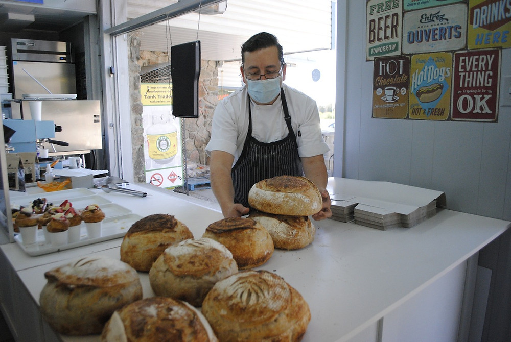 Need beer, smokes, and a loaf of organic sourdough bread? All can be purchased in one stop at the M&R Depanneur in Old Chelsea where Paco has been selling his specialty baked goods since January. Hunter Cresswell photo