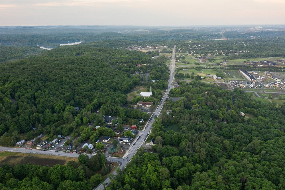 Aerial view of the Old Chelsea and Scott Road intersection looking east down Old Chelsea Road taken on June 22. Housing developments such as Hendrick Farm, Chelsea Creek, Padden Lofts, and Quartier Meredith can be seen in the distance. Photo courtesy Jesse Delgrosse