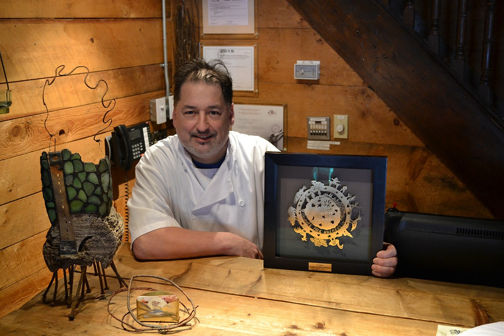 L'Orée du Bois chef and owner Jean-Claude Chartrand, pictured here in 2016 with his Frères Haeberlin Trophy competition prize, died last week. He was 53. Low Down file photo