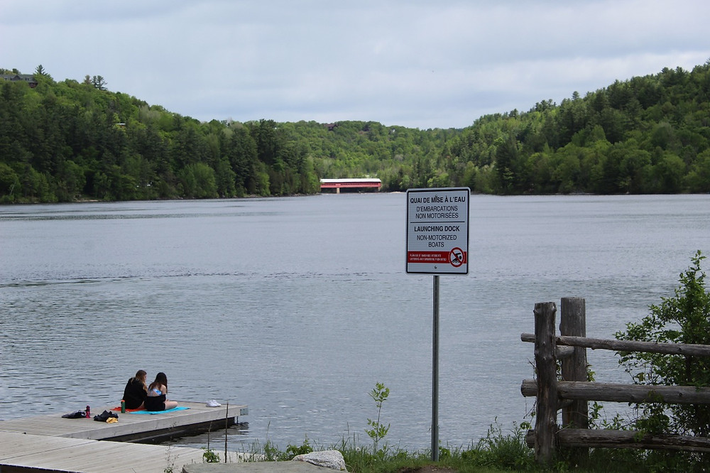 "Signs erected near public docks in Wakefield prohibiting ""loitering and swimming"" caused an uproar among residents. The signs have since been replaced with new ones encouraging social distancing and regular wash hand-washing. Stuart Benson photo"