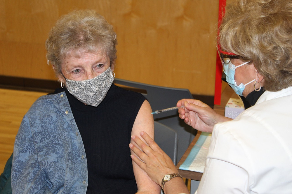 It's the light at the end of the tunnel for Marguerite Seguin, 85, as she received one of the first doses of the Pfizer COVID-19 vaccine at Centre Wakefield-La Pêche on March 11. Ninety-six residents of the Outaouais were vaccinated on the first day at Centre Wakefield-La Pêche and were registered to receive their second dose on July 2. Stuart Benson photo