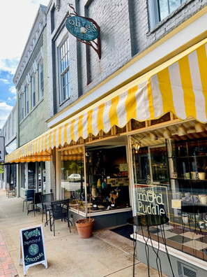 Olive's Mud Puddle, a place to paint, sip, sculpture and shop on Main St.