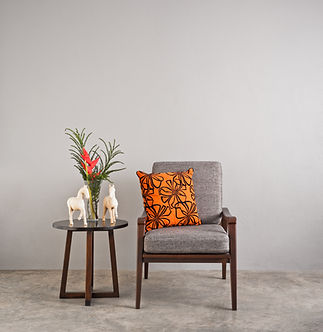 A chair and table behind the words contact us