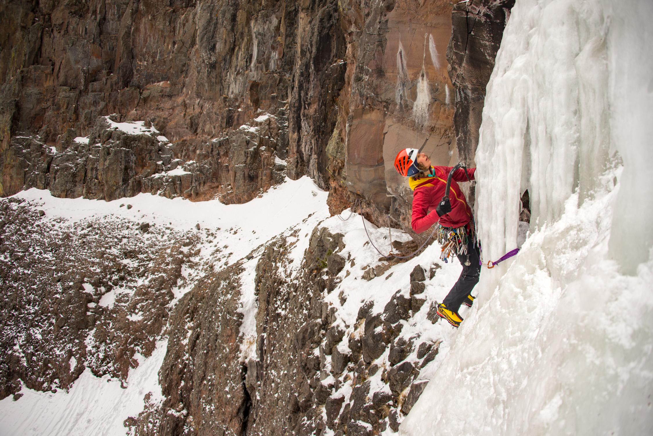 woman ice climbing outdoors