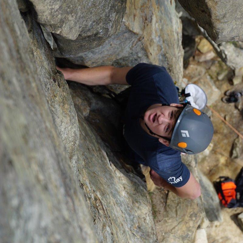 Guy rock climbing outside