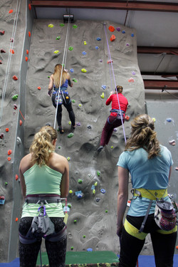 group of female rock climbers
