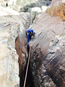 man climbing outdoors