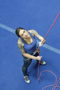 Woman belaying in a climbing gym