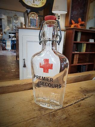 Petite bouteille premier secours années 50