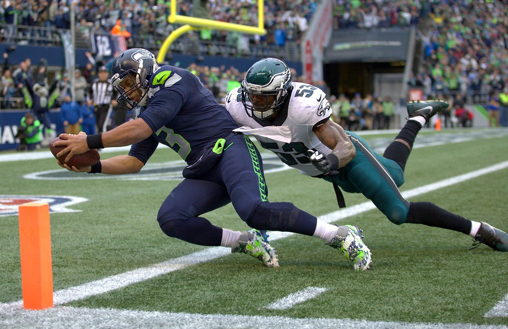 Seahawks quarterback Russell Wilson hauls in a pass from Seahawks wide receiver Doug Baldwin for a touchdown in the third quarter. (Dean Rutz / The Seattle Times)