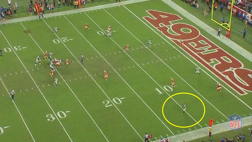 Wilson misses Lockett near the sideline where he is wide open.