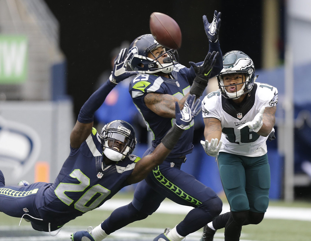 Seattle Seahawks cornerback Jeremy Lane, left, and free safety Earl Thomas, center, break up a pass intended for Philadelphia Eagles wide receiver Bryce Treggs in the first half of an NFL football game, Sunday, Nov. 20, 2016, in Seattle. (Stephen Brashear / Associated Press)