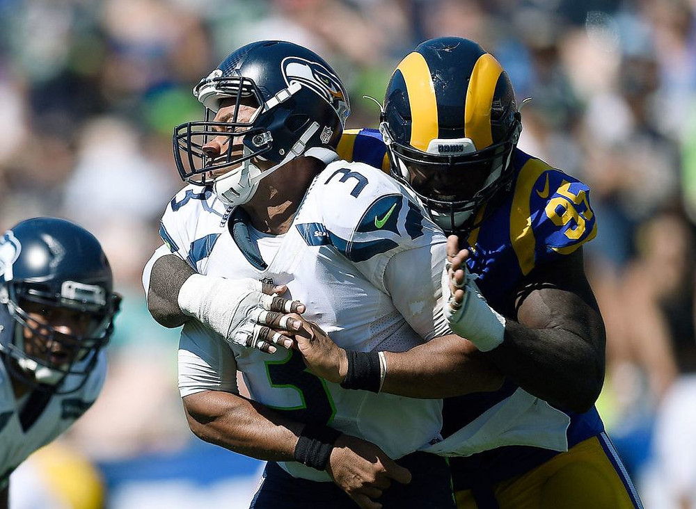AP Photo - Kevin Kuo - Russell Wilson is pressured and hit by Rams Defensive End William Hayes in their 9-3 loss against the Rams