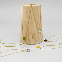 Mixed necklaces with wooden post.jpg