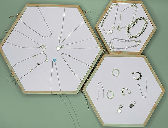 Mixed jewellery on hex green background.jpg