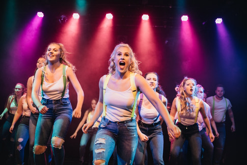 Girls Performing On Stage