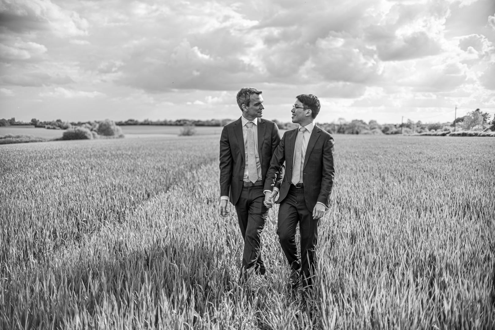 gay wedding photo in field