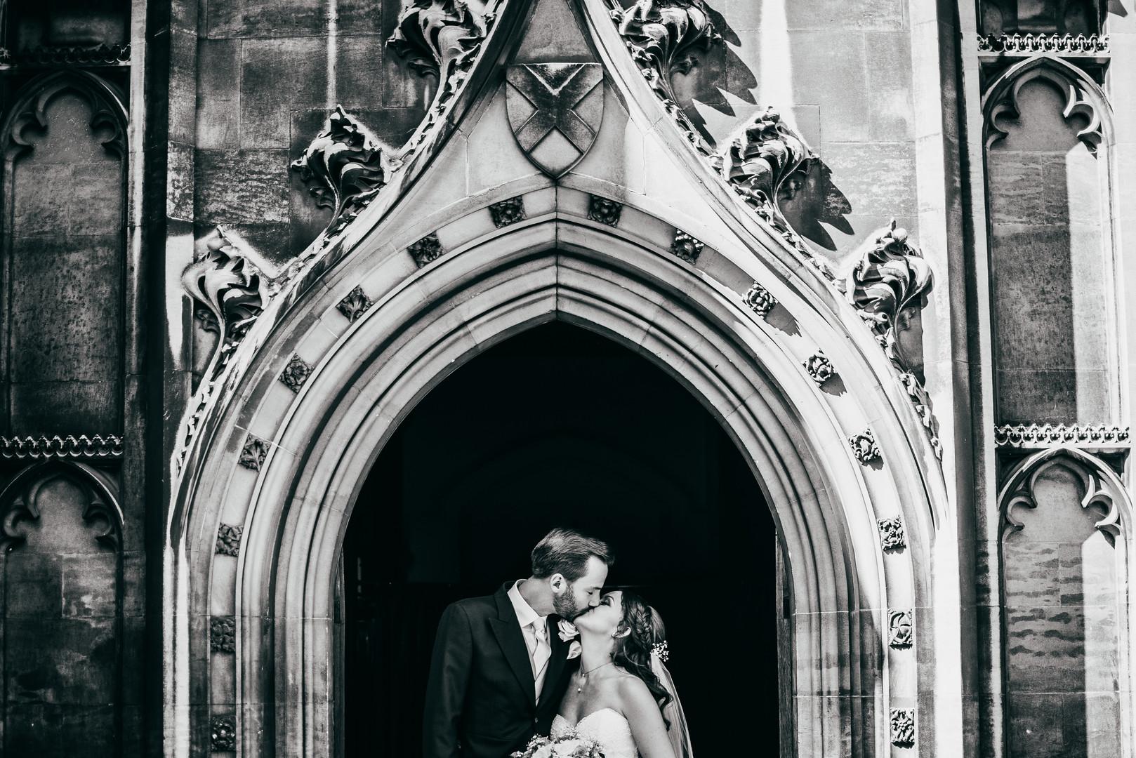 Kissing couple at wedding