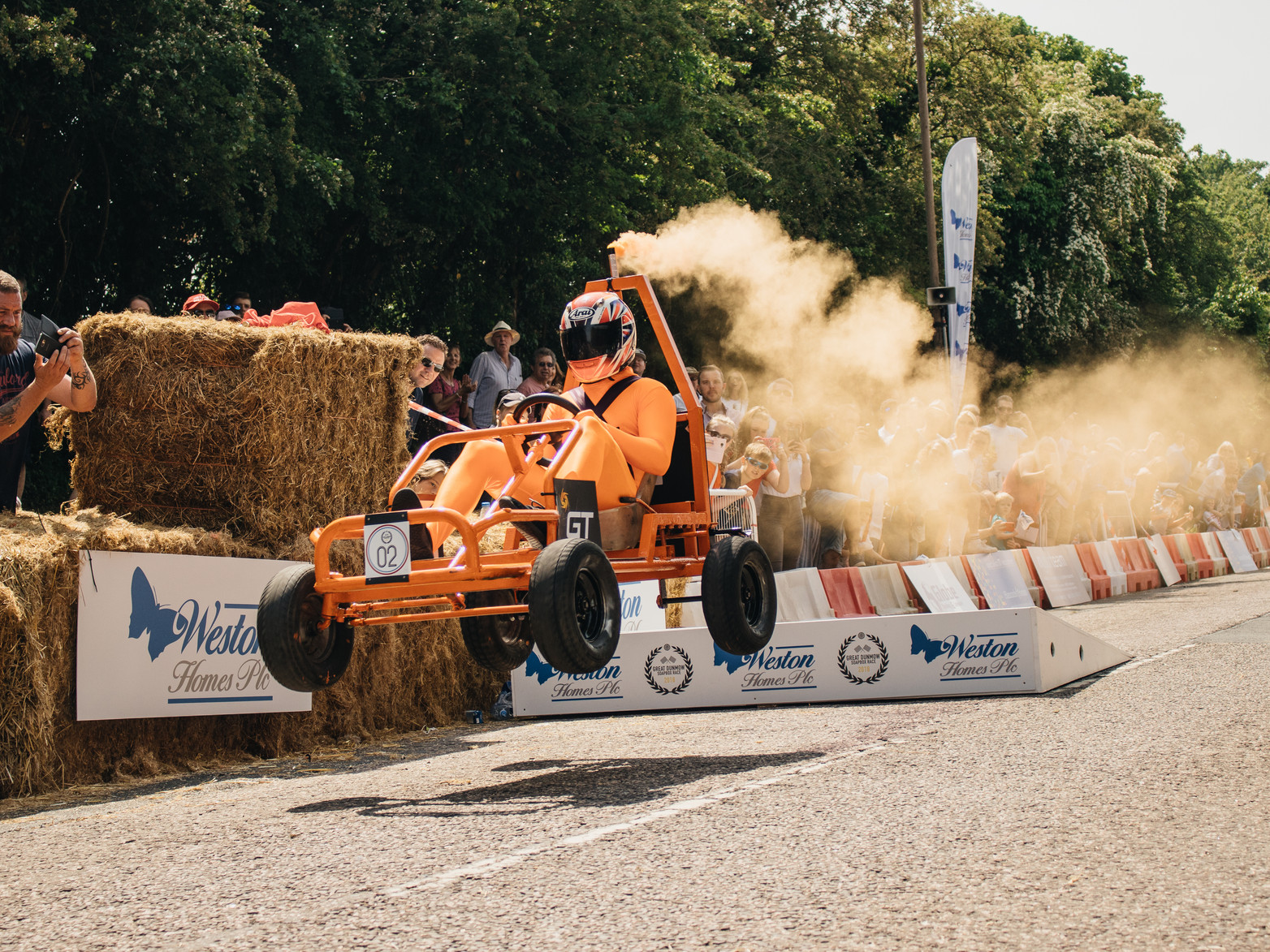 GT Engines orange soapbox with smoke going over jump