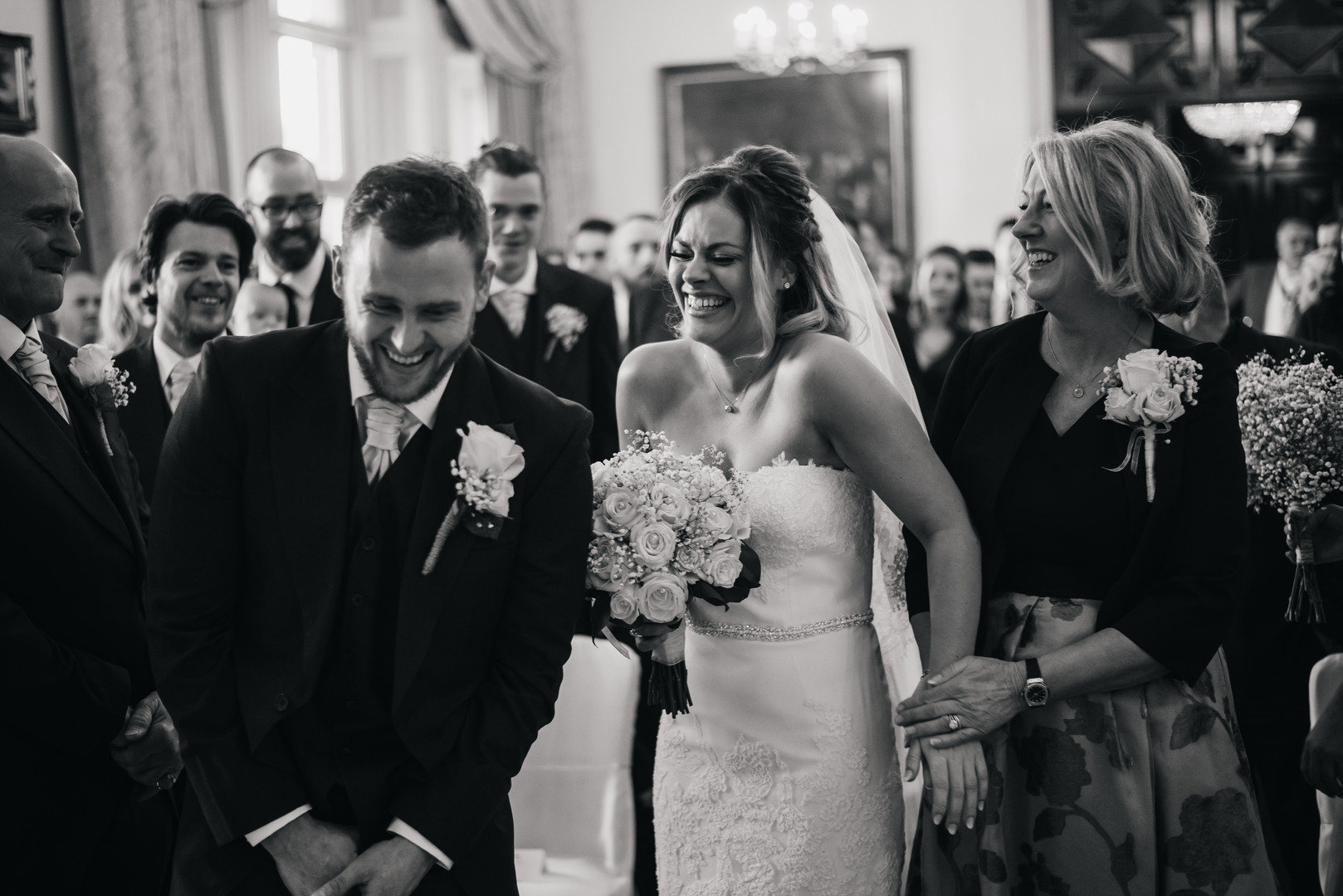 laughing couple at Gosfield Hall ceremon