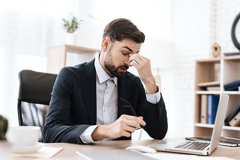 man-office-is-sitting-holding-his-head-p