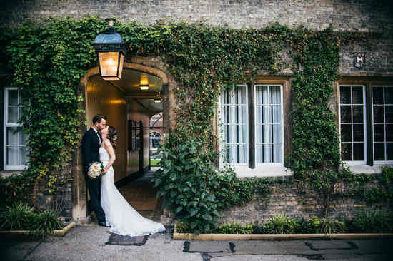 kissing couple at cambridge university wedding